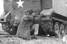 Federal agent kneels next to an APC peering through his rifle scope at AIM occupiers in Wounded Knee, 1973  Photo credit: Jim Hubbard