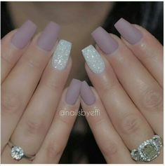 In love with the matte lilac and white bling ring finger nails.