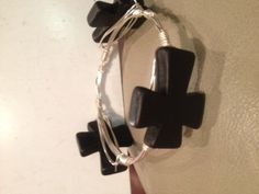 Handmade Black Crosses on Silver non-tarnishable wrapped wire on Etsy, $35.00