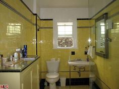 Yellow from floor to ceiling in this 1923 bathroom in Hancock Park.