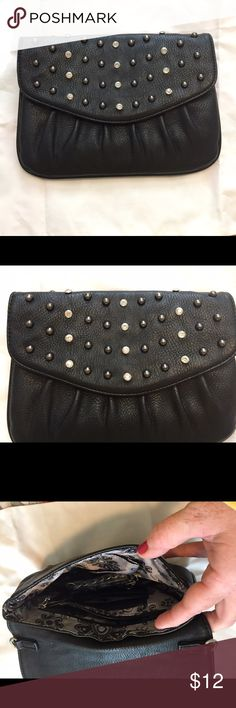 Black studded clutch purse Grace Adele black clutch purse. Bought as a Christmas gift and never used. Comes with a strap to use to carry on your shoulder but it's really cute as a clutch. It's in perfect condition. grace adele Bags Clutches & Wristlets