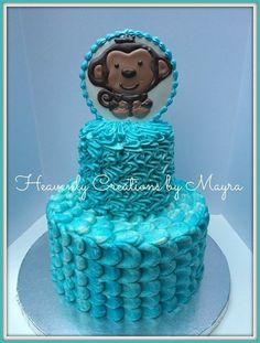 Baby Shower cake, marble cake covered with vanilla buttercream and a monkey decorated cookie topper
