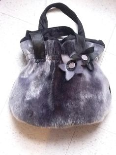 Inuit made sealskin purse by Molly Angootealuk
