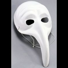 """The mask measures 14"""" long from the top of the head to the bottom of the beak. The beak itself is about 7"""" long."""