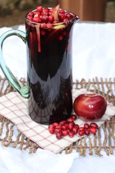 Holiday Sangria | The Defined Dish (made with apple cider, cinnamon sticks, apples, cranberries)