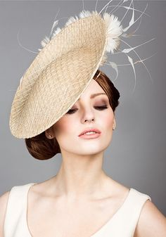 Rachel Trevor Morgan, S/S 2014. Straw mesh disc with feather flowers. #passion4hats
