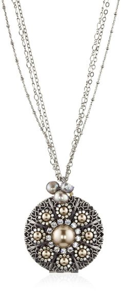 Such a pretty locket! Silver-plated metal with crystal and pearl accents. Lovely!