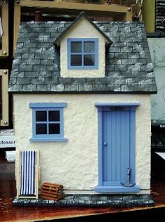 Via Julie's dolls house blog. I love the pretty blue door colour.