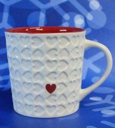 Starbucks embossed Valentine's Day white and red hearts coffee mug. 2007.