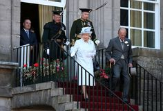 Queen Elizabeth II and Prince Philip, Duke of Edinburgh meet guests at a Garden Party at the Palace of Holyroodhouse on July 1, 2014 in Edinburgh, Scotland.