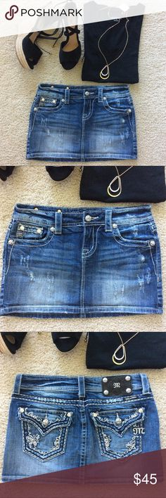"""Miss Me Denim Skirt Miss Me Denim Skirt. Super cute, super fun with distressing and rhinestones 💕 Pockets, belt loops. Front zip and button closure. Laying flat waist approx 14 3/4"""" across. Approx 12"""" long. 98 cotton 2 elastane. Size 26/2. Excellent condition. #965 Miss Me Skirts Mini"""
