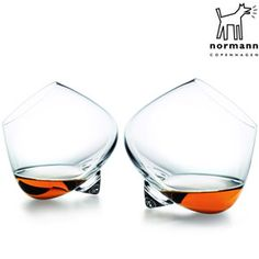 These cognac rocking glasses are a true design classic from Danish designers Norman Copenhagen. The Normann Copenhagen cognac rocking glasses are Liqueur Glasses, Whiskey Glasses, Cool Wine Glasses, Funky Glasses, Shot Glasses, Alcohol Glasses, Norman Copenhagen, Copenhagen Design, Basement Bars