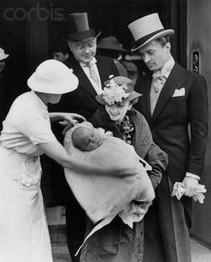 Barbara Hutton, after the christening ceremony of the 3-and-1/2-months-old baby. With Count Haugwitz-Reventlow and the countess' father, Franklyn Hutton, the chapel of Marlborough House, London 1936