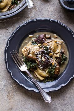 Taleggio Ravioli with Garlicy Butter Kale and Mushroom Sauce + Toasted Pine Nuts…