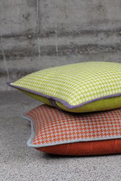 """CUSHION CAVALLO COCO The cushion Cavallo Coco captivates with a lime coloured houndstooth pattern on the front and fine pinstripes on the back. Piping in a different colour gives it that """"certain something"""" that sets it apart. Wool collection by Création Baumann AG"""