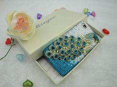 Rhinestone Peacock phone case. I could totally do a syracuse case, with a cute cabochon orange bow at the top.