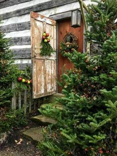 This rustic cabin doorway with simple Christmas decorations is gorgeous! Log Cabin Christmas, Christmas Porch, Green Christmas, Primitive Christmas, Outdoor Christmas, Country Christmas, Simple Christmas, Winter Christmas, Christmas Decorations