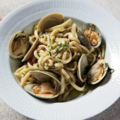 "Spaghetti with Clams and Garlic | ""I look forward to going to Sicily for many reasons,"" says Frank Castronovo of his biannual trip to southern Italy. ""One of them is because I'm amazed at how many times Frank [Falcinelli] can order linguine con vongole."" Their exquisite, supersimple version is packed with garlic and a judicious amount of crushed red pepper. If you prefer, shell the clams before tossing them with their juices in the pasta."