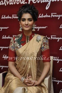 Bollywood Actress Sonam Kapoor is wearing a closed neck pink heavy thread embroidered blouse for a contrast cream colour saree. Indian Attire, Indian Outfits, Indian Wear, Ethnic Outfits, Indian Clothes, Lehenga, Anarkali, Sabyasachi Sarees, Sari Blouse Designs