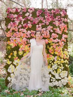 AREA DECOR: Photo shoot wall: Lovely wedding dress from Ruche and gorgeous wall of ombré flowers!