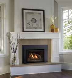 Contemporary Gas Fireplace Inserts With White Fireplace Mante Contemporary Gas Fireplace Inserts With White Fireplace Mante Molly Kamine Contemporary Gas Fireplace Inserts With White Fireplace Mantel Surround nbsp hellip Corner Fireplace Mantels, Corner Electric Fireplace, Fireplace Mantel Surrounds, Fireplace Tile Surround, Cozy Fireplace, Fireplace Inserts, Fireplace Design, Fireplace Ideas, Mantel Ideas