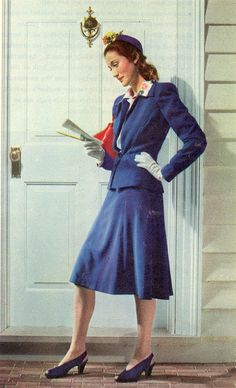 A wonderful royal blue skirt suit with matching hats and shoes, 1942.