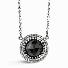 Black Diamond Fixed Pendant Necklace with Halo  Like a prized medallion symbolizing a great accomplishment, this 2.16 carat rose cut black diamond fixed pendant necklace stands convicted and [...]