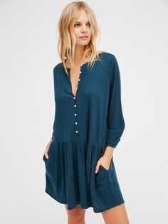 Button Up Dress | Lightweight dropwaist long sleeve mini dress featuring an effortless, oversized fit. Delicate buttondown detailing. Hip pockets.