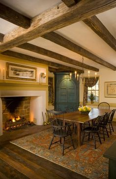 Colonial Dining Room...love the rustic ceiling beams & blue corner cupboard.