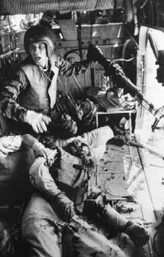 LARRY BURROWS  Near Da Nang, Vietnam, 1965  Crew Chief James Farley, with his guns jammed and two wounded comrades aboard, shouts to his gunner. (LIFE)  This photo was the  LIFE Magazine cover on April 16, 1965.