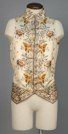 Waistcoat, court suit coat and waistcoat, France, 1774-1793. Purple devore velvet, lavishly embroidered with silk polychrome exotic floral, silk and linen lining; waistcoat: cream silk with matchin embroidery in variant colours, silk lining.