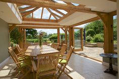 Stunning oak orangery, perfect for entertaining guests and living an indoor-outdoor lifestyle. The bifolding doors and glazed lantern help to bring the outdoors in and encourage natural light into the room. Garden Room Extensions, House Extensions, Kitchen Extensions, Kitchen Extension Family Room, Room Kitchen, Orangery Extension, Cottage Extension, Indoor Outdoor Living, Outdoor Decor