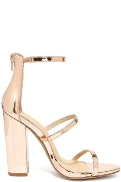 """The Fifi Mirror Rose Gold Ankle Strap Heels will always RSVP to the hottest parties of the season! Shiny, mirrored vegan leather is molded to slender straps that create a stylish caged vamp atop a peep-toe. 3.25"""" heel zipper."""