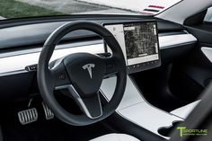 Performance Tesla Model 3 with Matte Carbon Fiber Steering Wheel by T Sportline