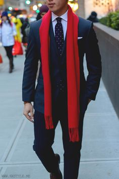 A red scarf is a great way to add a pop of color to your suit.