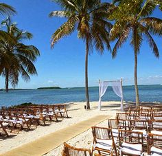 Key Largo Lighthouse Beach Wedding Ceremony with Palm Trees and Wedding Arch in the Sand