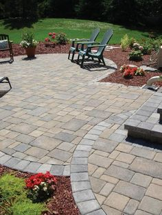 Charming Random Pattern Pavers Are Enhanced By The Use Of A Contrasting Color Course  For This Patio