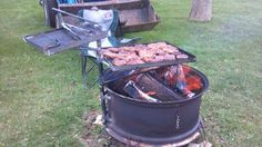 Home made. Tractor tire rim fire pit. With grill racks