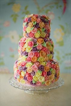 This colorful cake is decorated with tons of beautiful and vivid roses. Perfect for the woman who loves lots of flowers, and bright bold colors on her wedding day.