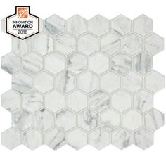 Procure an exquisite and overwhelming appeal to the walls or floors when you use this LifeProof Carrara Ceramic Mosaic Tile. Gives glazed matte finish. Ceramic Mosaic Tile, Mosaic Wall Tiles, Marble Mosaic, Glazed Ceramic, Carrara Marble, Modular Walls, Ceramics, Tile Flooring, Floors
