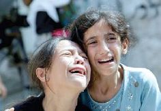"Scared to death: Those two little Syrian girls has just lost their parents, brothers and their home. They have no one now. They don't know where to go, how to hide from the bombardment of the thugs and what to do. Give your ""say"" and let it come from your heart; then do something positive. Have mercy on those innocent people who are brutally massacred daily there."
