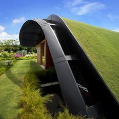 Sky Garden House, Singapore ~ The curved roof at the top is covered in grass and affords views of the bay beyond. Is that not incredible?!!