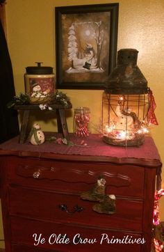 My primitive guest bedroom .. With cover let and dressed for Christmas snowman .  By Ye Crow primitives