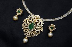 Diamond pendent set from Naksha jewellers. An elegant diamond pendent with emerads in the middle and pearl drops. Gold Pendent, Diamond Pendant, Diamond Jewelry, Gold Jewelry, Diamond Rings, Filigree Jewelry, Emerald Pendant, Ruby Rings, Diamond Necklaces