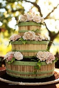 "These bushel baskets look amazing when stacked as a ""cake"" and embellished with flowers!"
