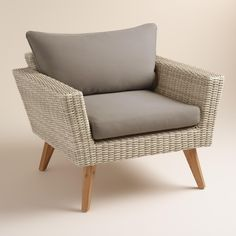 With iconic mid-century-style splayed acacia wood legs, our mixed-material chair features a weather-resistant aluminum frame hand woven with resin wicker. Gray polyester cushions and a deep seat create a comfortable spot to lounge outdoors - especially when paired with our coordinating occasional bench and coffee table.