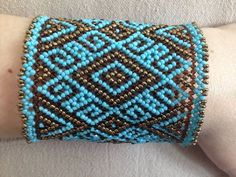Beaded netting bracelet cuff pattern This pattern is based on huichol art. The patterns require comprehension of netting stitch! Instruction how to do netting (huichol) stitch you can buy on site: Peyote Patterns, Loom Patterns, Bracelet Patterns, Beading Patterns, Netted Bracelet, Seed Bead Bracelets, Seed Bead Projects, Loom Bands, Loom Beading