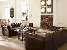 Switch out the mirrors with a bold painting, and add a smidge more color.  Love the couches!