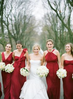 Bridesmaids -- Gorgeous shade of Red. See the  wedding on http://www.StyleMePretty.com/midwest-weddings/2014/04/02/classic-military-wedding-at-milwaukees-pfister-hotel/ The McCartneys Photography - meetthemccartneys.com