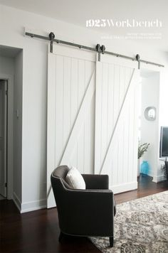 Single track bypassing barn door hardware to make a den into second bedroom in this condo.